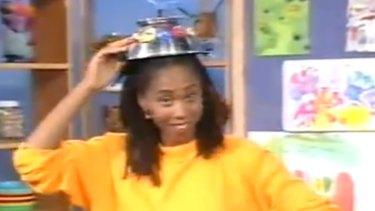 Trisha Goddard with a robot hat on Play School in 1991.
