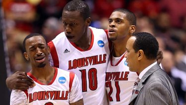 Tears for a teammate ...  Russ Smith, left, is distraught.