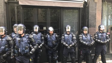 Riot police assemble ahead of a Anti/Pro Trump rally in Melbourne