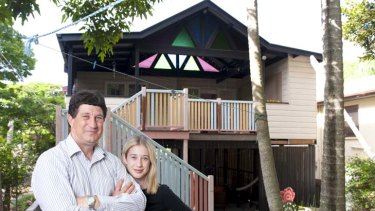 New foundations ... Tony Moore and his daughter Georgia at their rebuilt house.