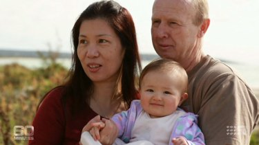 David and Wendy Farnell with baby Pipah on 60 MInutes.