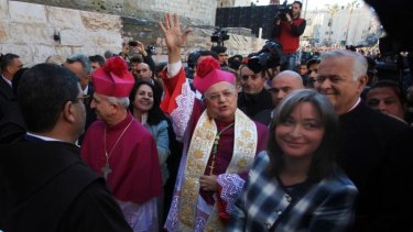 Latin Patriarch of Jerusalem Fouad Twal, centre, arrives to the Church of the Nativity, traditionally believed by Christians to be the birthplace of Jesus Christ on Christmas Eve in the West Bank town of Bethlehem.