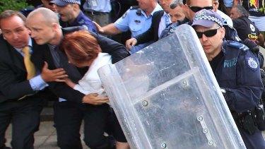 Lost her blue-suede shoe ... Prime Minister Julia Gillard leaves the restaurant.