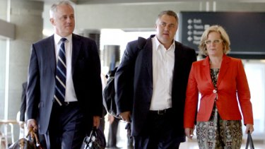 Malcolm Turnbull with wife Lucy Turnbull and Joe Hockey arrive at Sydney airport yesterday.
