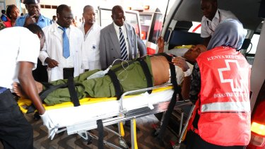 Medics help an injured person at Kenyatta national Hospital in Nairobi, Kenya, after an attack by gunmen at Garissa University College.