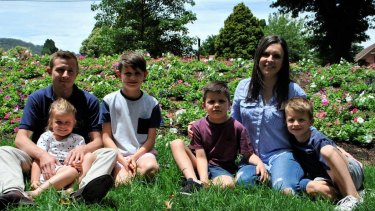 Riley (in the maroon shirt) pictured with mum Kayla, dad Stephen, brothers Brayton and Hudson and sister Henley.