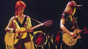 David Bowie as Ziggy Stardust with Mick Ronson (right) in 1972.