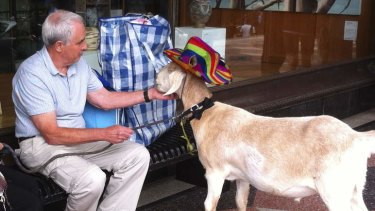 """Bleating not guilty ... Gary with John, the father of goat owner """"Jimbo Bazoobi""""."""
