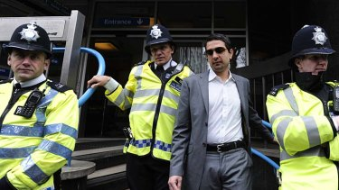 Sporting agent Mazhar Majeed (second right) leaves Westminster Magistrates court in central London, on March 17.