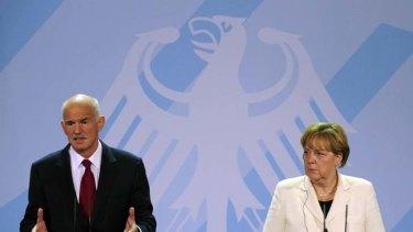 Tough times ... German Chancellor Angela Merkel and Greek Prime Minister George Papandreou.