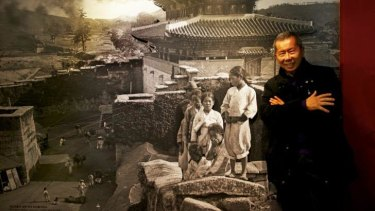 William Yang with one of Clunes-born photographer George Rose's first images from Korea.