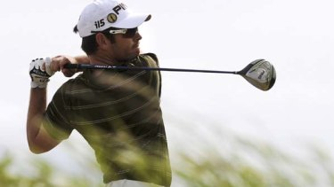 Louis Oosthuizen of South Africa tames the Old Course in St. Andrews, Scotland.