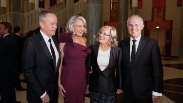 Opposition Leader Bill Shorten, Chloe Shorten, Lucy Turnbull and Prime Minister Malcolm Turnbull arrive for the Midwinter Ball at Parliament House in Canberra on Wednesday.