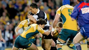 Opening Gambit ... halfback Luke Burgess stops Sonny Bill Williams in his tracks during a Wallabies-Barbarians match at the SFS last year.