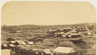Pioneer photographer Richard Daintree captured the manmade devastation of the Forest Creek diggings in this view of Golden Point in 1858. The taller buildings on the horizon line is the highway where Robert Hewett began to build a house after his family lived in a tent for six years.
