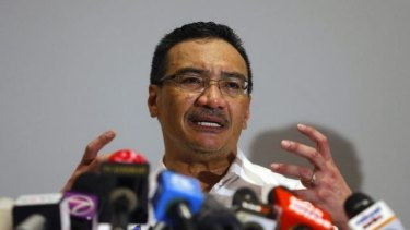 Expensive search ... Malaysia's Acting Transport Minister Hishamuddin Hussein speaks about the cost of searching for missing Malaysia Airlines Flight MH370 at a news conference in Sepang on Wednesday.
