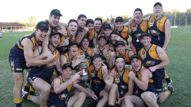 Finally: Echuca United players celebrate the 2013 premiership.