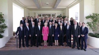 Governor-General Quentin Bryce poses for photos with Prime Minister Tony Abbott and his new ministry at Government House in Canberra on Wednesday.