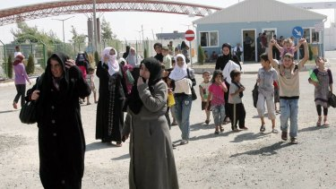 Syrian refugees arrive at the Oncupinar refugee camp in Kilis near the Syrian border. The swelling numbers of refugees on Turkish soil are putting an enormous strain on Ankara, which is pushing for safe zones inside Syria to shelter them as it confronts security-related problems at home.