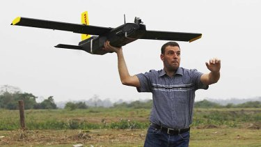 Remo Peduzzi, managing director of Research Drones, launches a UAV for flight at the Kaziranga National Park.