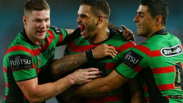 Greg Inglis feels the love from Chris McQueen and Bryson Goodwin.