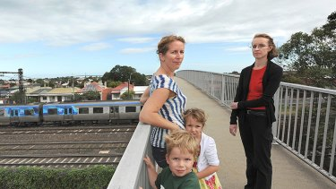 Shannon Lea (left) and Michelle Wyatt oppose plans to demolish two Footscray footbridges.