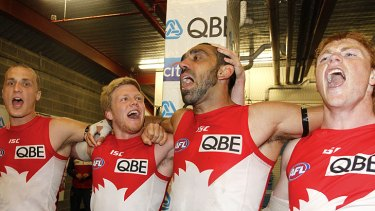 With feeling: Ted Richards, Dan Hannebery, Adam Goodes and Gary Rohan belt out the team song after beating the Cats.