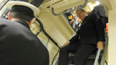 One step at a time: Kevin Rudd on board HMAS Stuart.