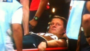 English team physio Gary Lewin being stretchered off field after celebrating a goal.