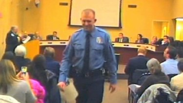 Police officer Darren Wilson attends a city council meeting in Ferguson, Missouri on February 11.