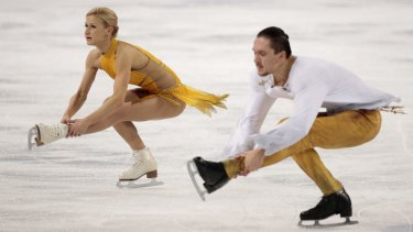 Performing to Jesus Christ Superstar: Russian figure skaters Tatiana Volosozhar and Maxim Trankov win gold in the pairs free skating competition at the Iceberg Skating Palace.