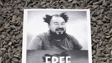 A protest poster placed on an Ai Weiwei work  at London's Tate Modern.
