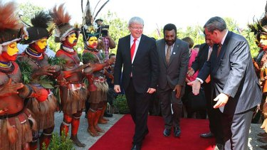 Traditional welcome: Prime Minister Kevin Rudd arrives in Port Moresby on Monday.