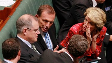Opposition Leader Tony Abbott with his deputy, Julie Bishop, and immigration spokesman Scott Morrison in Parliament yesterday.