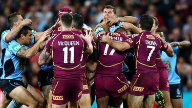 Out of fashion?: Blues and Maroons players fight during game two of State of Origin.