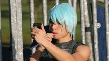 William Wong putting on the final touches to transform into a video game character.