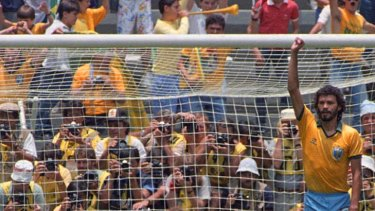 Socrates celebrates after scoring Brazil's first goal against Poland as Polish goalkeeper Jozef Mlynarczyk watches, during a World Cup soccer match in Guadalajara in 1986.