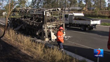 The scene of a bus fire on the Warrego Highway on Tuesday. Photo: Seven News.