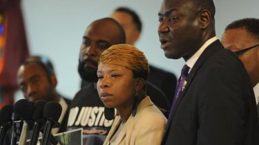 Lesley McSpadden, mother of slain 18 year-old Michael Brown speaks next to Mr Brown's father, Michael snr (left) and their lawyer Benjamin Crump.