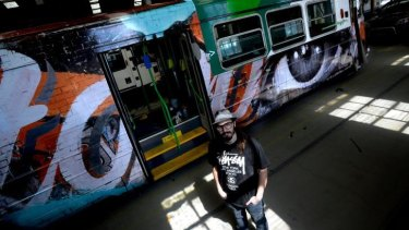 Art on the move: Rone stands in front of a tram he decorated.