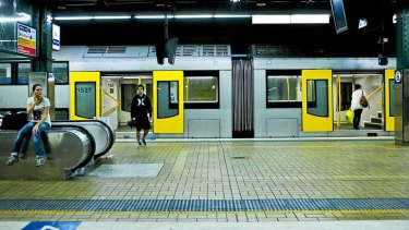 A standard double-decker train at Sydney's Town Hall Station.