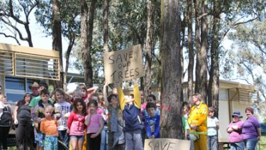 Education revolution ... students and parents at Kurrajong East school protest against the tree felling. Stimulus projects at up to 695 schools are affected.