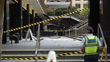 Police have cordoned off the forecourt at the Suncorp building after a large concrete slab fell 10 storeys to the ground.