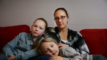 Jade Marr with her children Kendall, 10, and Jackson, 7, at their Warners Bay home.