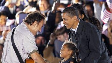 Barack Obama introduces daughter Sasha to Springsteen.