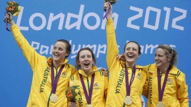 (L-R) Australia's Ellie Cole, Katherine Downie, Annabelle Williams and Jacqueline Freney celebrate winning gold for the women's 4x100m medley 34 points final during the London 2012 Paralympic Games.