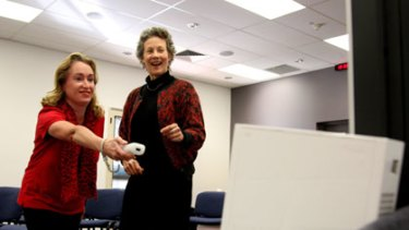 Help at hand ... stroke patient Marianne McDonald uses the Wii as therapy with Dr Penelope McNulty.