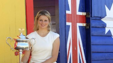 Shining star ... Kim Clijsters shows off the Australian Open trophy at Brighton Beach after her victory last year.