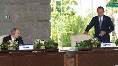 Russian President Vladimir Putin notes Prime Minister Tony Abbott's late arrival to an APEC meeting.