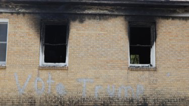 """""""Vote Trump"""" is spray painted on the side of the fire-damaged Hopewell MB Baptist Church in Greenville, Mississippi."""